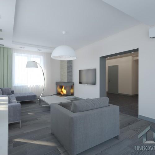 Интерьер в гостиной с каминой в коттедже